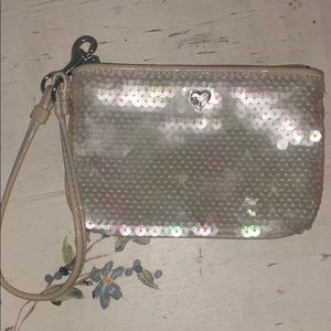 white sequined COACH wristlet